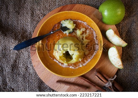 baked apple with cinnamon on a plate, soft focus