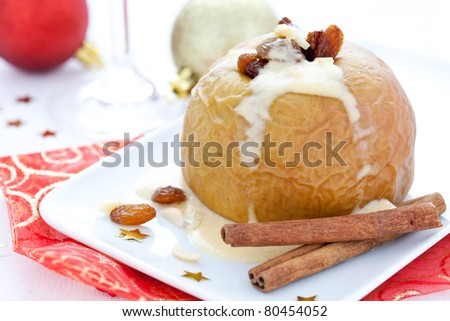 baked apple with raisin for christmas - stock photo