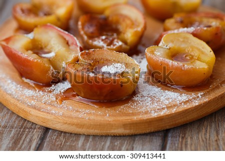 Baked apples  on a cutting board - stock photo