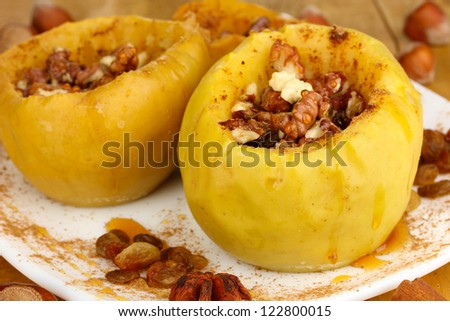 Baked apples on plate close up - stock photo
