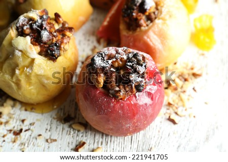 Baked apples on table close up - stock photo