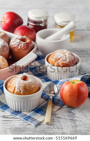 Baked apples on wooden table, christmas dinner