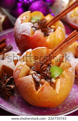 baked apples stuffed with cheese,honey,nuts,raisins and cranberries poured caramel sauce for christmas dessert - stock photo