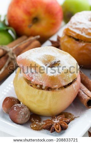 baked apples stuffed with dried fruit, nuts and cottage cheese, close-up, vertical - stock photo