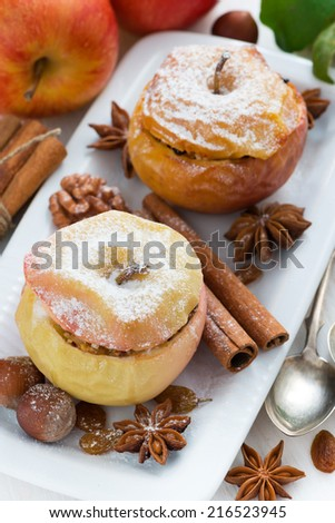baked apples stuffed with dried fruit, nuts and cottage cheese, top view, vertical - stock photo