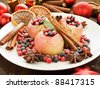 Baked apples with wild berries and spices. Shallow dof. - stock photo