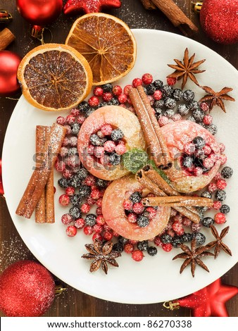 Baked apples with wild berries and spices. Viewed from above. - stock photo