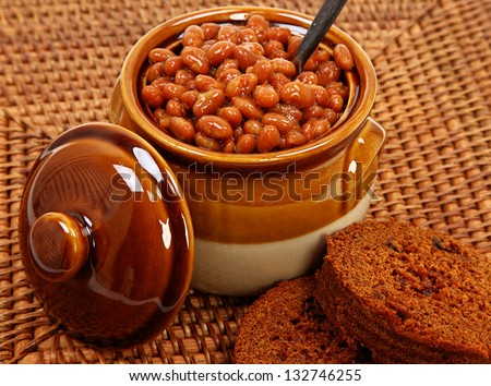 Baked Beans And Brown Bread On Placemat - stock photo