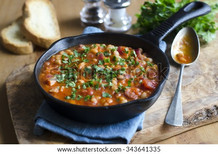Baked beans and streaky bacon with toasted soda bread - stock photo