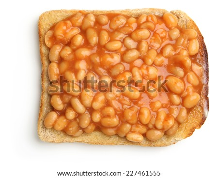 Baked beans on buttered toast. - stock photo