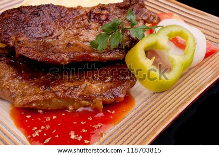 Baked beef steak with tomato sauce - stock photo