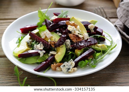 baked beetroot salad with blue cheese and avocado, closeup - stock photo