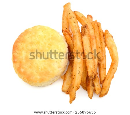 baked biscuit and french fries on white background