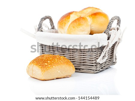 Baked bread bun in basket. isolated on white - stock photo