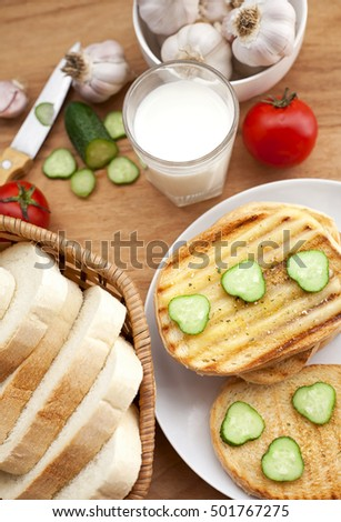 baked bread, milk and vegetables for breakfast