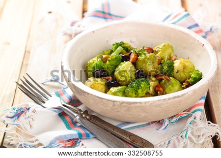 Baked Brussels sprouts with almonds and grapes.  - stock photo