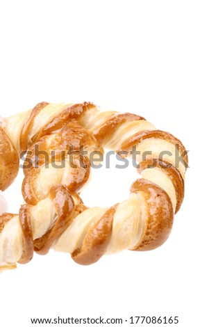 Baked bun with honey. Isolated on a white background. - stock photo