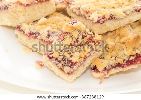 Baked cakes on white plate - stock photo