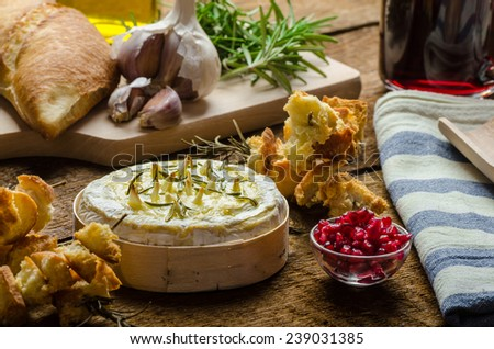 Baked Camembert with Garlic & Rosemary, with toast baked on rosemary stalk, fresh pomegranate, just DIP IN! - stock photo