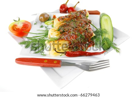 baked cannelloni served on square white plate