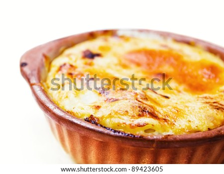 Baked cheese pasta served in a clay pot  (shallow dof)