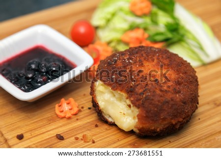Baked Cheese with sweet sauce and vegs - stock photo