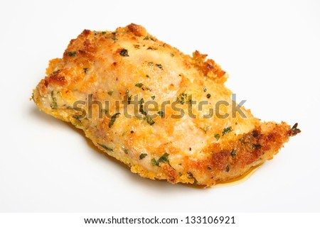 Baked chicken kiev breast of chicken filled with garlic butter. - stock photo