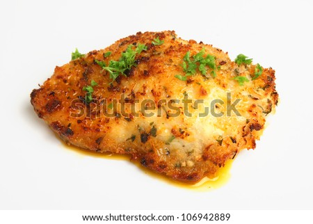 Baked chicken kiev stuffed with garlic butter - stock photo