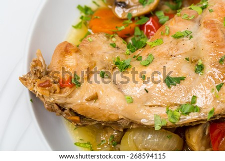 Baked chicken leg with tomatoes and mushrooms. Can be used as a whole background.