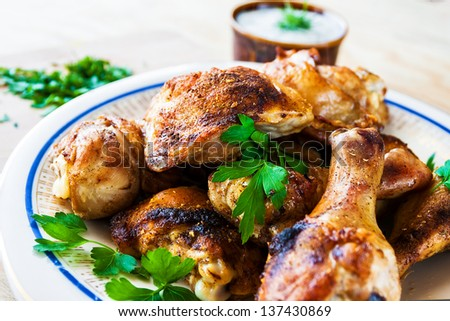 Baked Chicken legs with parsley on wooden board - stock photo