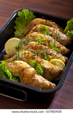 baked chicken thighs with herbs - stock photo
