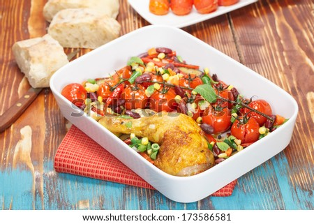 Baked Chicken with Cherry Tomatoes , vegetables and spices. Macro, selective focus