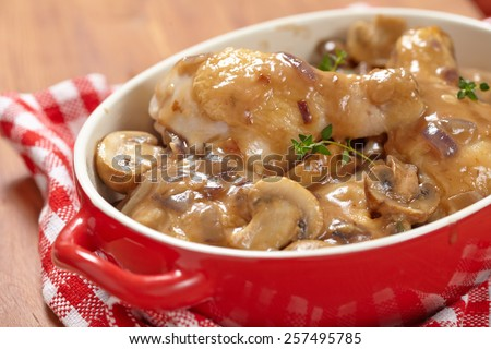 Baked chicken with mushroom and onion in baking dish - stock photo