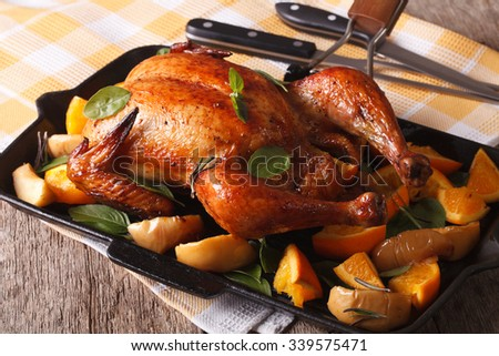 Baked chicken with orange and basil close-up on a frying pan. horizontal - stock photo
