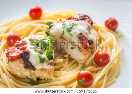 Baked chicken with parmesan and mozzarella - stock photo