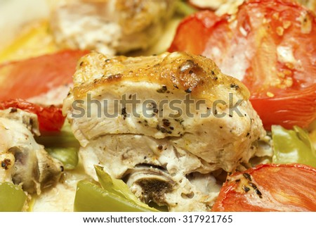 baked chicken with peppers and tomatoes close up