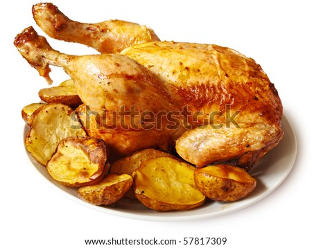 Baked chicken with potatoes over white background - stock photo