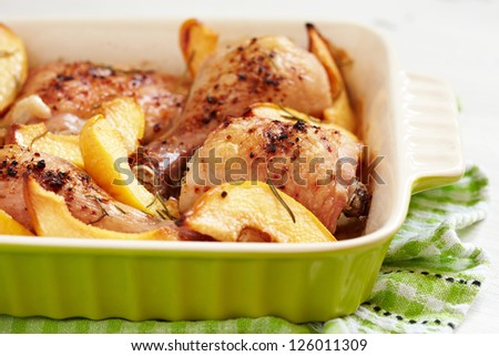 Baked chicken with quince - stock photo