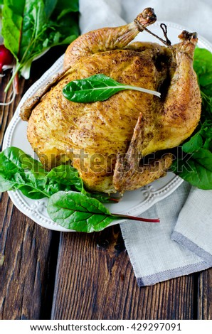 Baked chicken with spices and chard leaves - stock photo