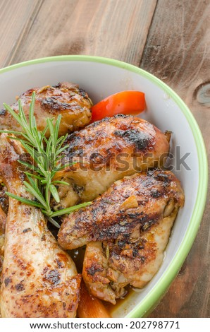Baked chicken with thyme, soy sauce and garlic on butter