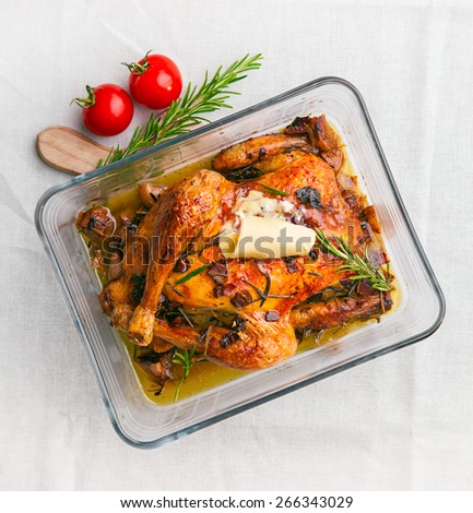 baked chicken with vegetables in glass casserole - stock photo