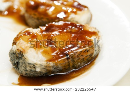 Baked cod fish with honey sauce.