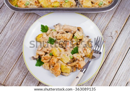 Baked Creamy Chicken, Potato  and Mushrooms. View from above, top studio shot - stock photo