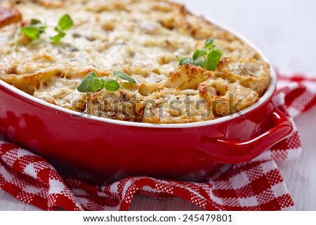 Baked crepes roll with chicken, cheese, mushroom and bechamel sauce - stock photo