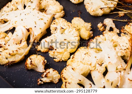 Baked cut cauliflower on the frying pan - stock photo