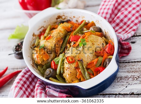 Baked, diet and healthy a chicken fillet with vegetables.
