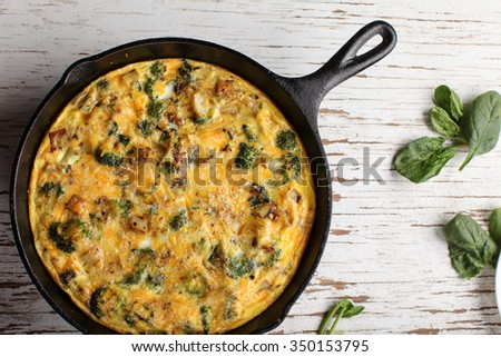Baked egg frittata with spinach, cheese, broccoli, red potatoes, bacon ...