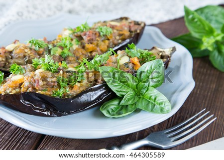 baked eggplant stuffed with vegetables, meat and cheese. selective focus