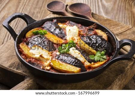 baked eggplant with potato greek style - stock photo