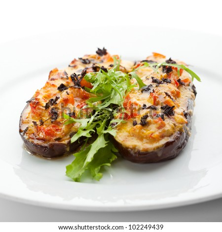Baked Eggplant with Vegetables. Garnished with Fresh Greens - stock photo
